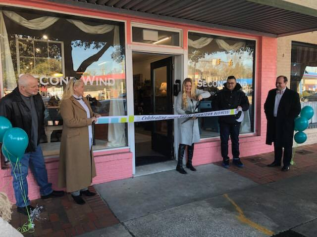 Owner Cybil cuts the ribbon to open Second Wind Furniture Shoppe in Downtown Hartsville, SC.